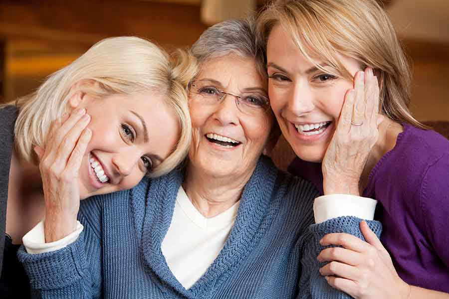 Three Generations Of Women Smiling Together
